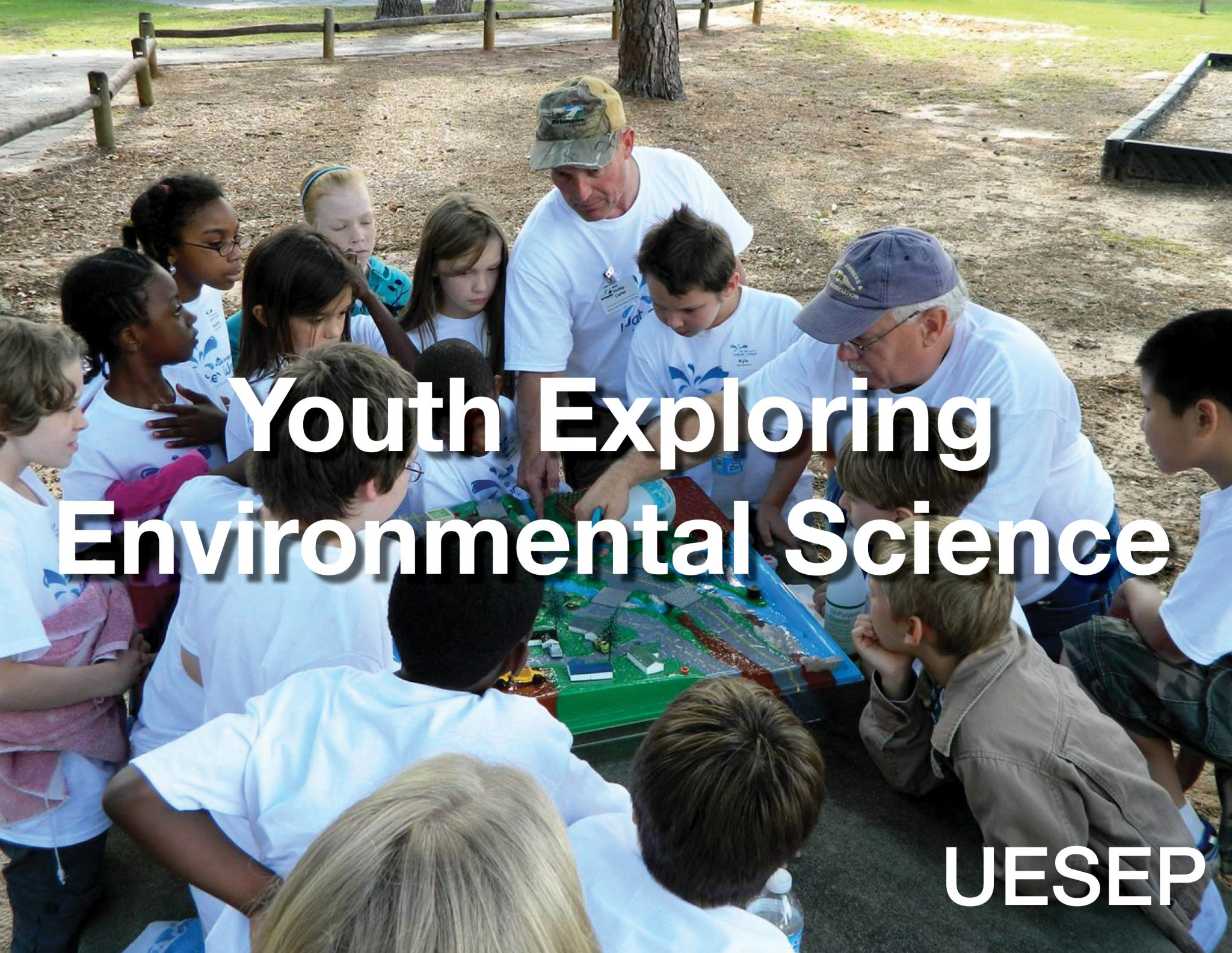 A group of elementary students participate in a watershed demonstration