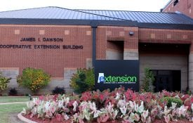 Exterior of the Dawson building with Extension sign in front