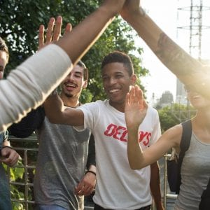 A group of teens give each other high fives