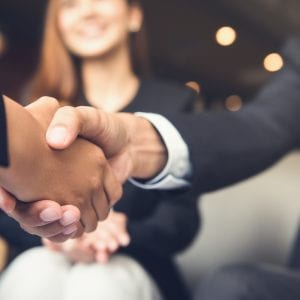 Close up of a handshake between businessmen