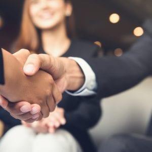 Close up of a handshake between businessmen