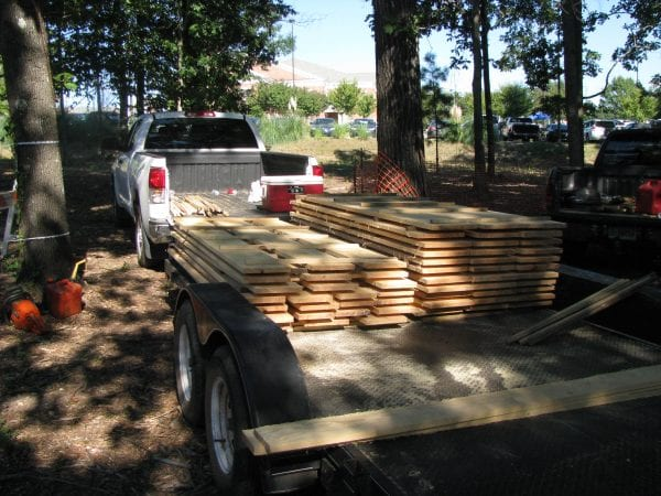 Moving lumber instead of whole logs is a major benefit of operating a portable sawmill. (Photo credit: John Gilbert)