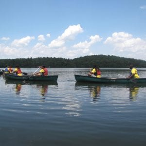 Participants a in canoes exploring the lake.