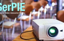 DVD projector in classroom projecting an educational movie.