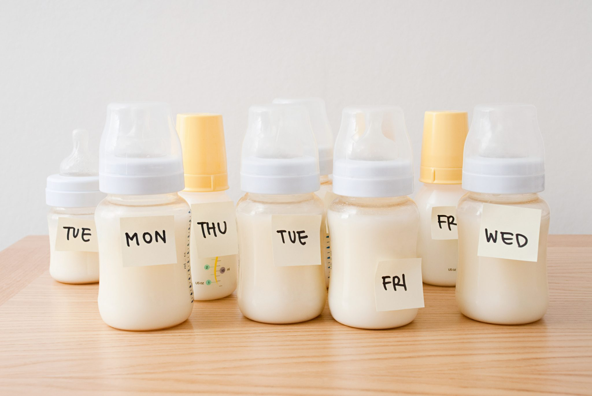 Baby bottles with days of the week on adhesive notes