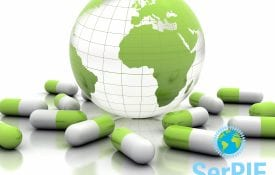Illustration of a globe resting next to spilled pills