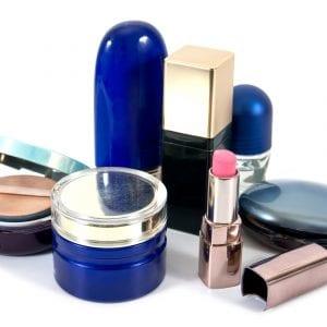 Old cosmetics set isolated on white background