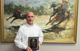Josh Elmore winning the outstanding educator award.