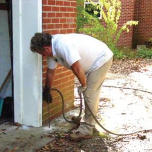 Man spraying for termites