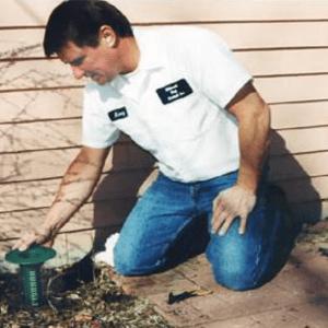A man spraying for termites
