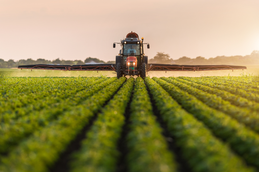 Tractor spraying soybeans