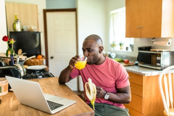 African American man eating breakfast.