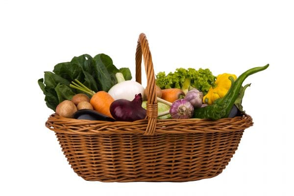 Wicker Basket with vegetables Isolated on a white background