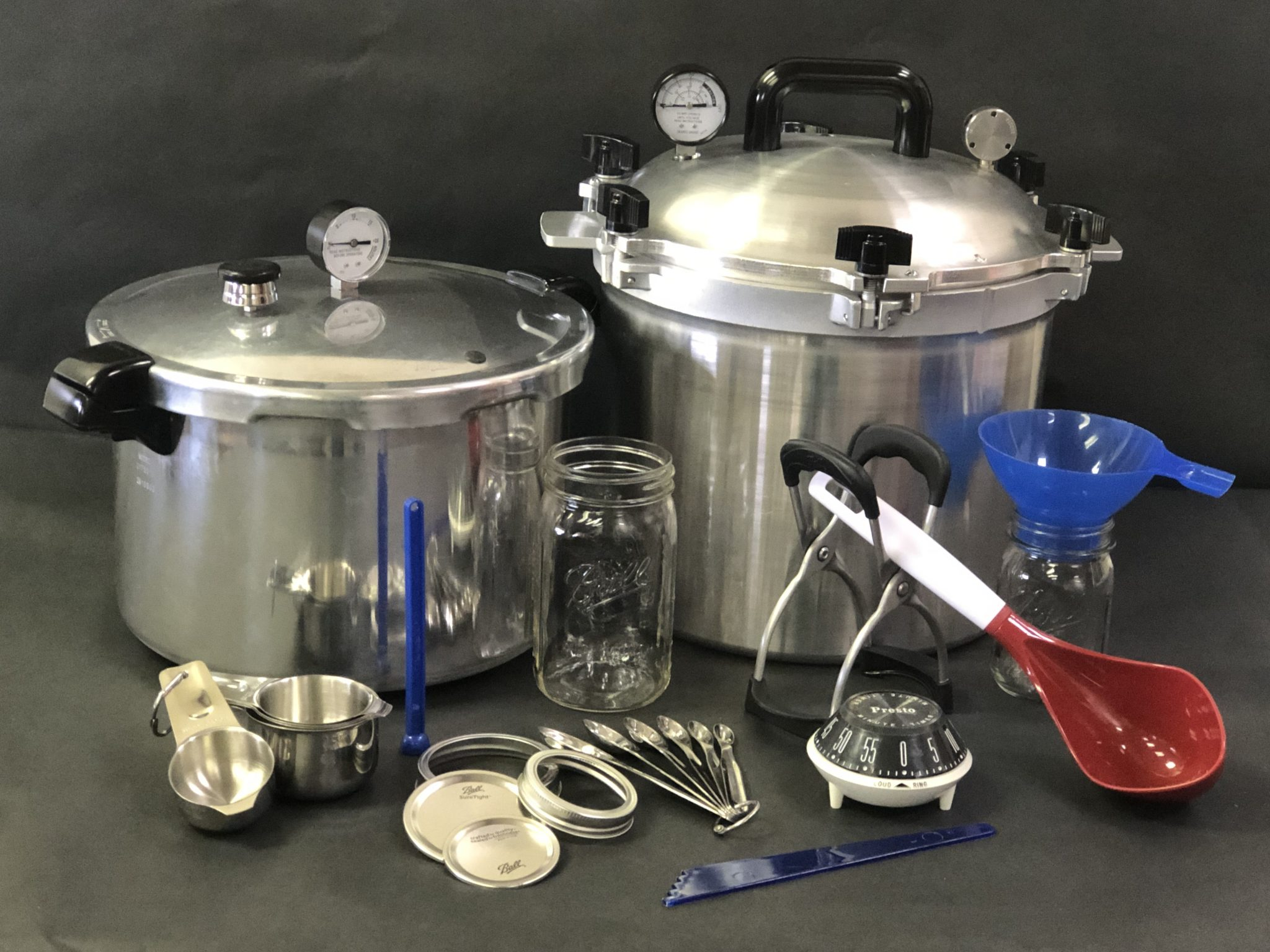 Figure 1. Tools for proper canning. Never process low acid vegetables or meat in a boiling water canner. See the chart in table 1 for proper canning times and pressure.