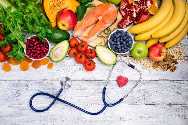 Healthy food for heart. Fresh fish, fruits, vegetables, berries and nuts. Healthy food, diet and healthy body concept.