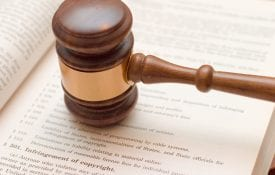 Copyright law concept: gavel over 17 U.S.C. 501 (copyright infringement)
