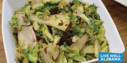 A warm Brussels sprouts and pear salad in a bowl.