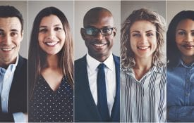 Smiling group of ethnically diverse businessmen and businesswomen