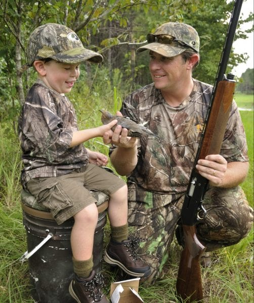 man and boy dove hunting