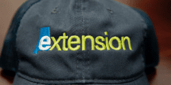navy cap with Alabama Extension logo