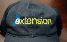 navy cap with Alabama Extension logo