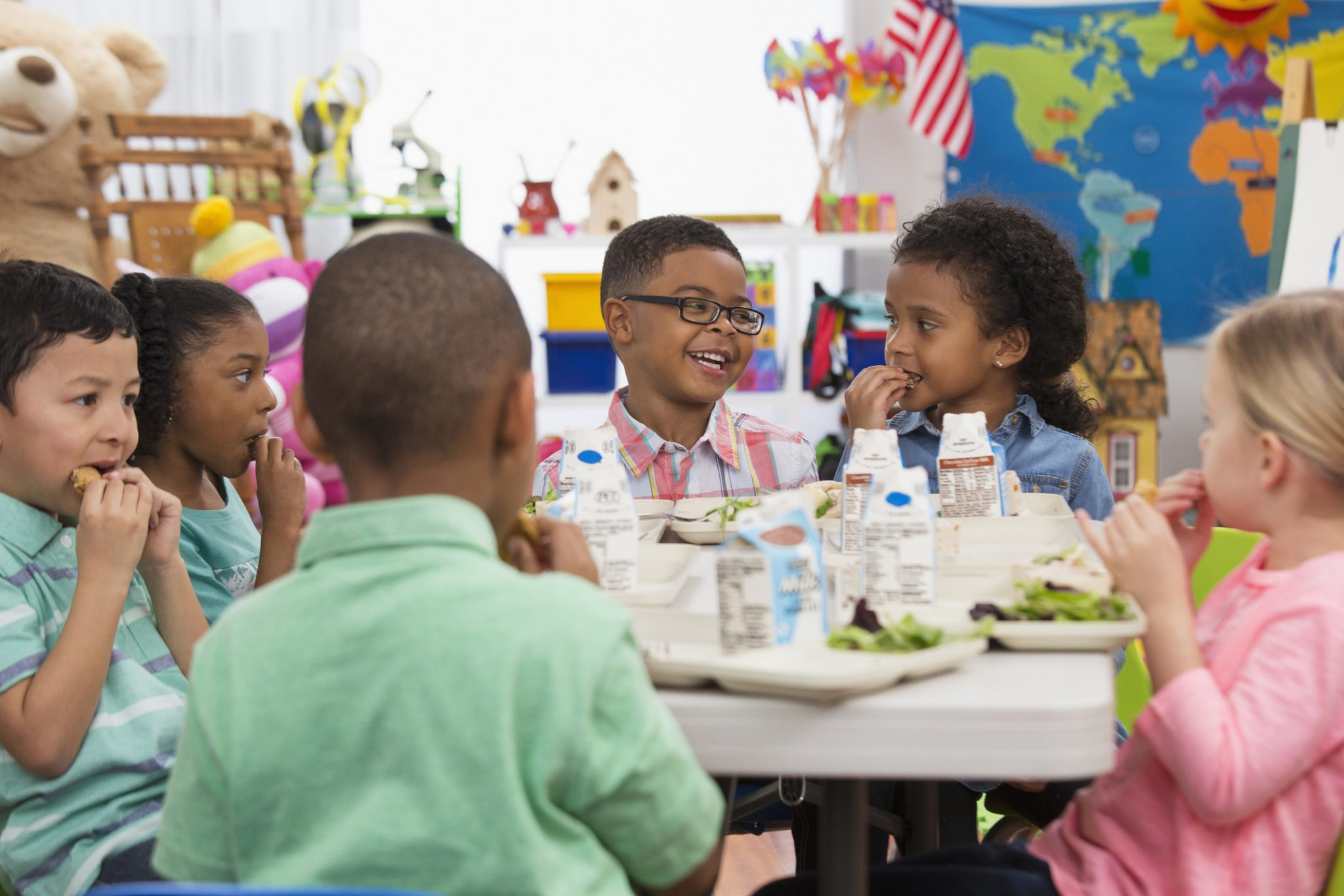 Young students eating lunch at school