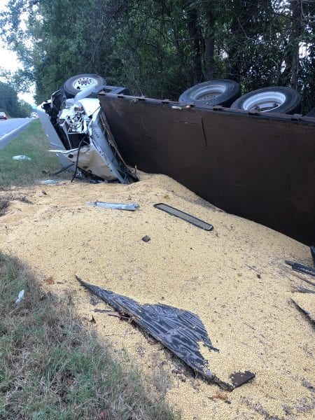 Overturned truck hauling soybeans