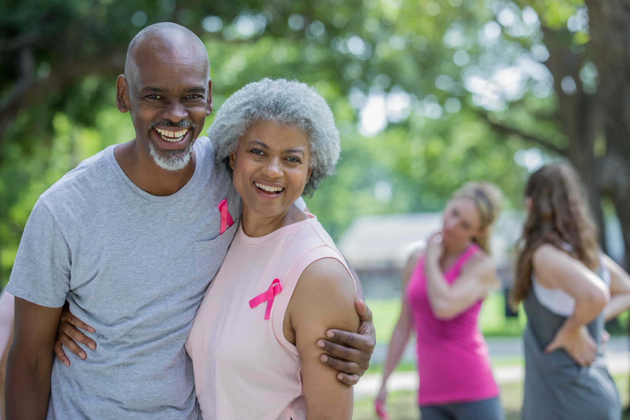 Senior couple attending charity breast cancer race for the cure.