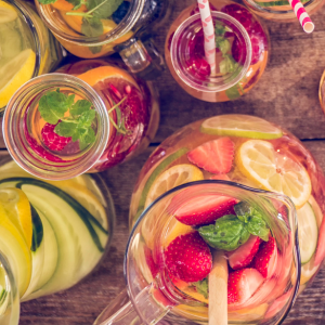 Fruit-infused water sitting on a table.