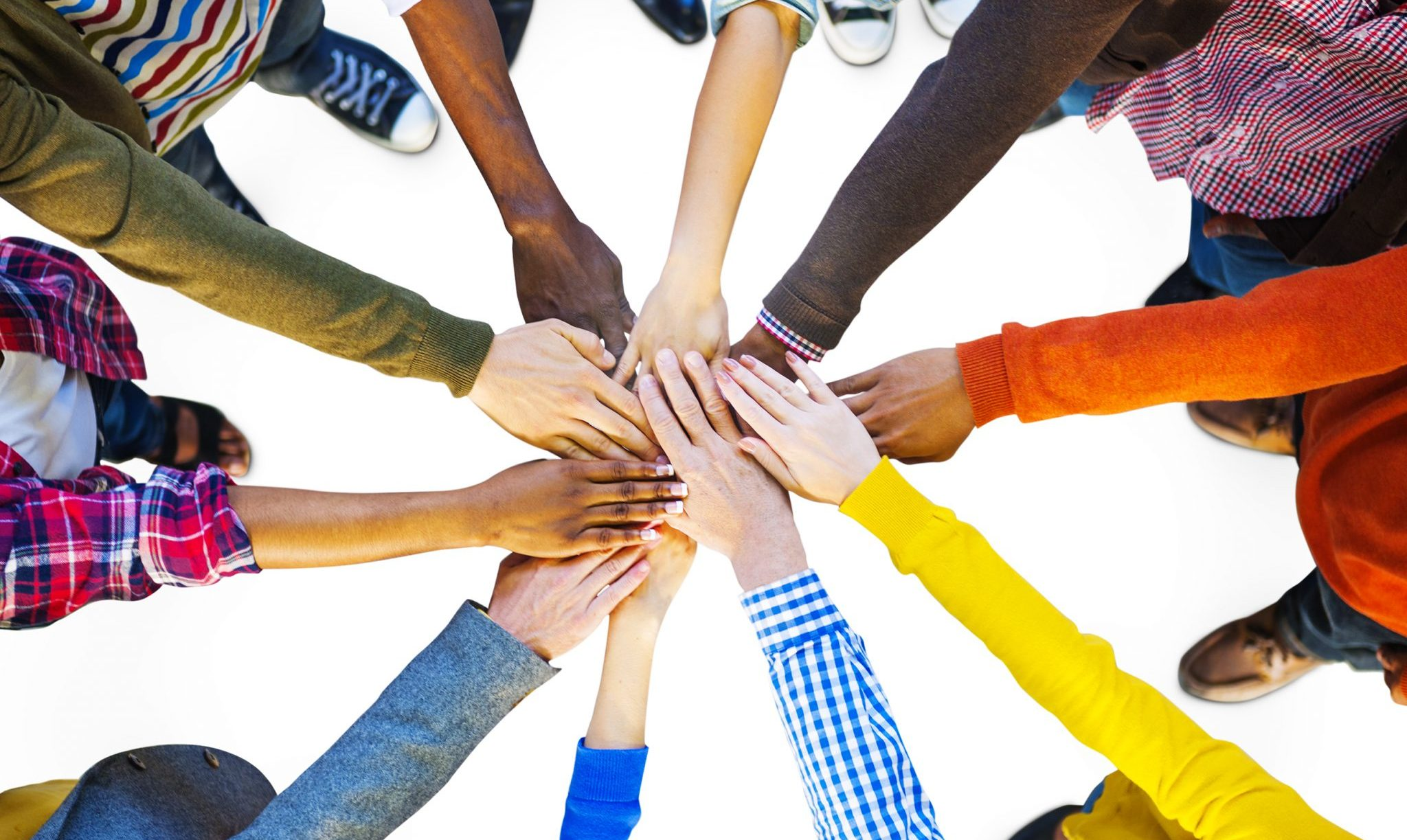 Group of Diverse Multiethnic People reaching hands in to have a group high five