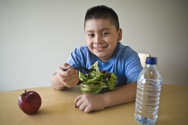 Latino boy eating a healthy meal