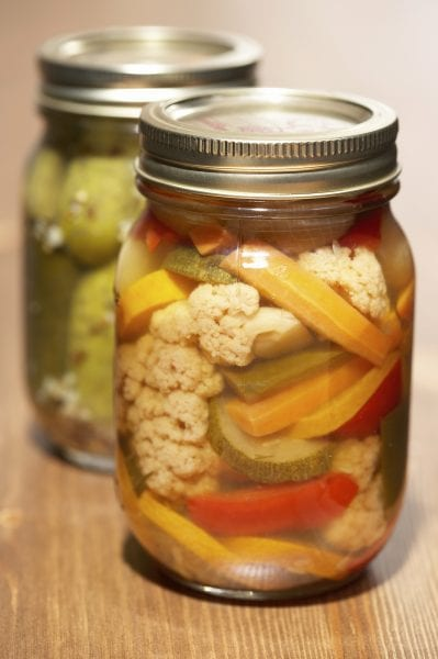 Jars with pickled food in them