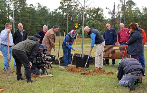 Planting tree in Beauregard. Brodbeck assisting