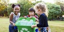 Children holding a recycling bin