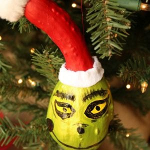 The Grinch Christmas decorations on a tree.
