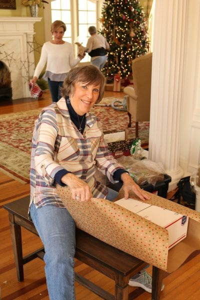 A woman wrapping a holiday package.