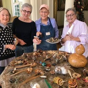 A group of ladies making Christmas decorations.