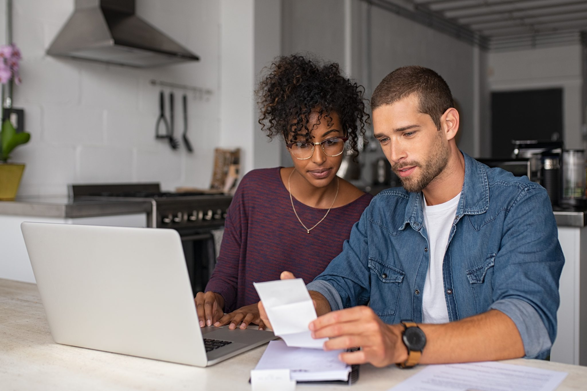 Young couple looking over bills and paperwork