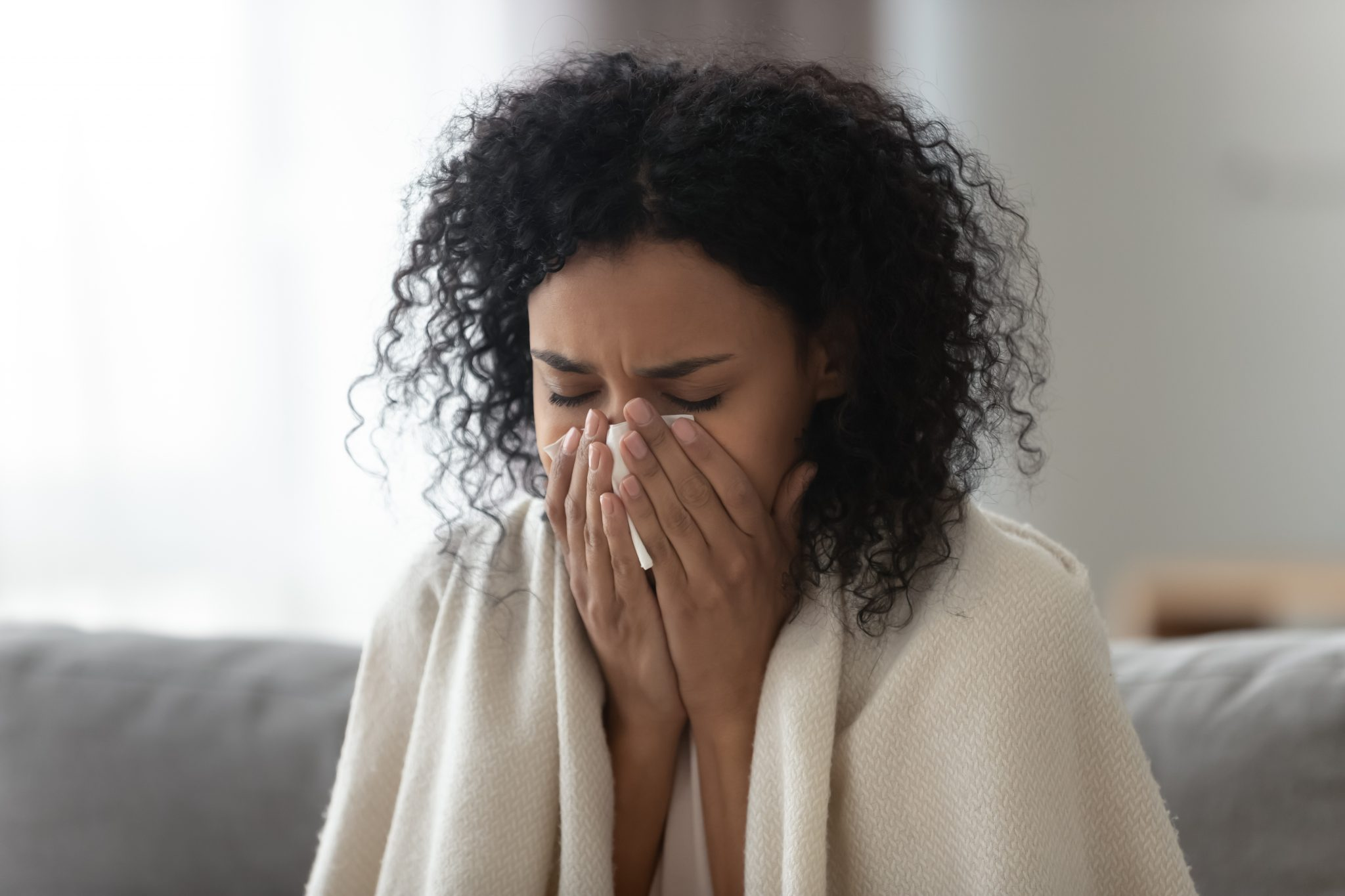 African American woman dealing with a sickness