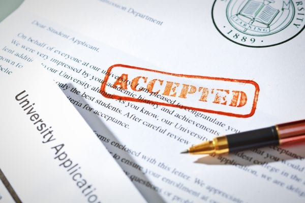 University Application Acceptance Letter Still Life with Rubber Stamp of ACCEPTED
