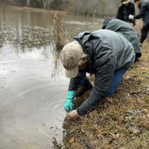 AWW volunteer taking water samples