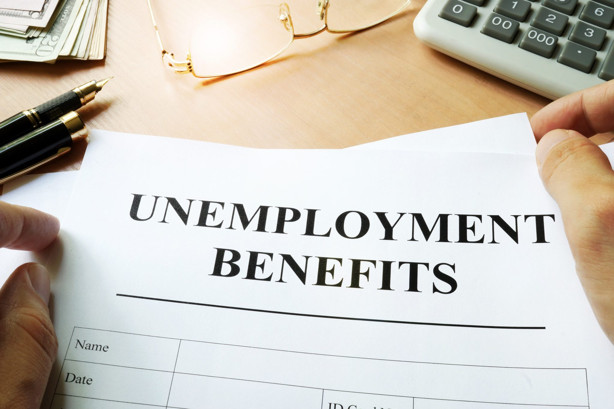 Unemployment benefits form on a table.