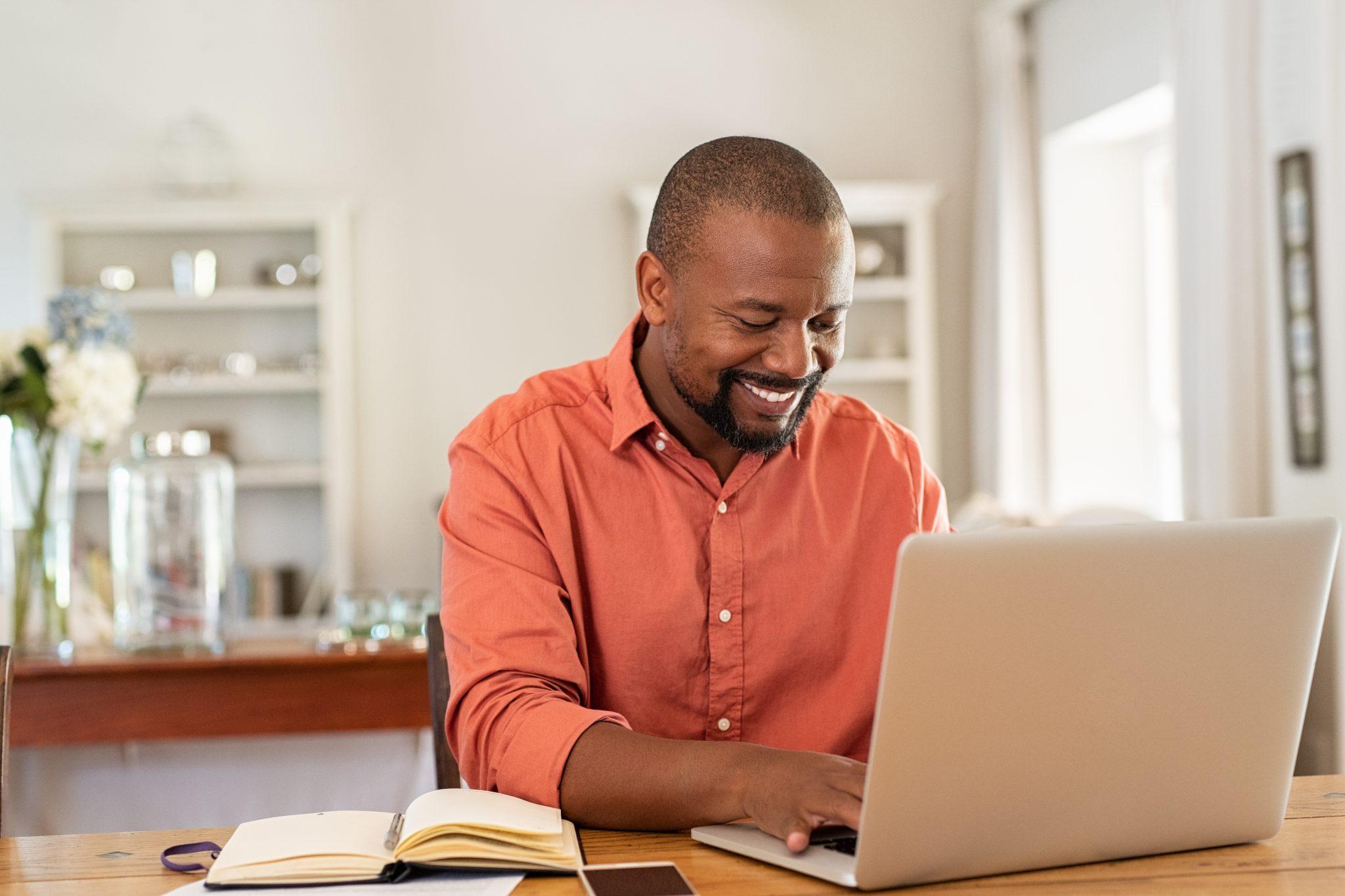 Man sitting at a computer at home.
