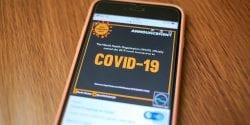 A smartphone displaying coronavirus information.