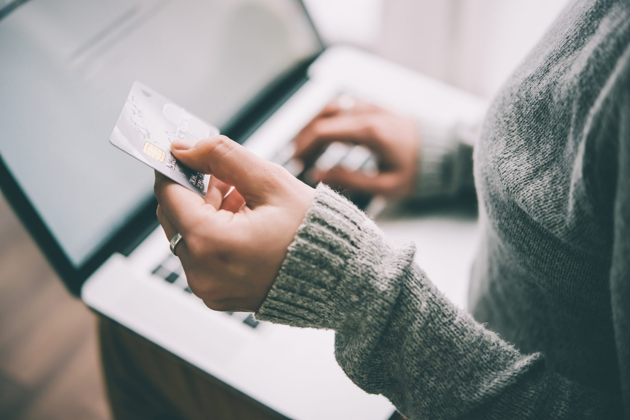 A person using a credit card.