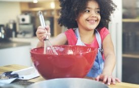 Young girl cooking