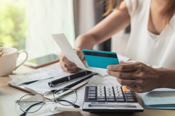 Woman with bills and credit card.