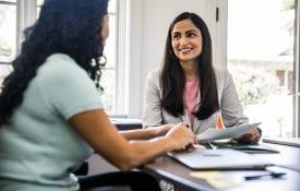 Women interviewing in business office