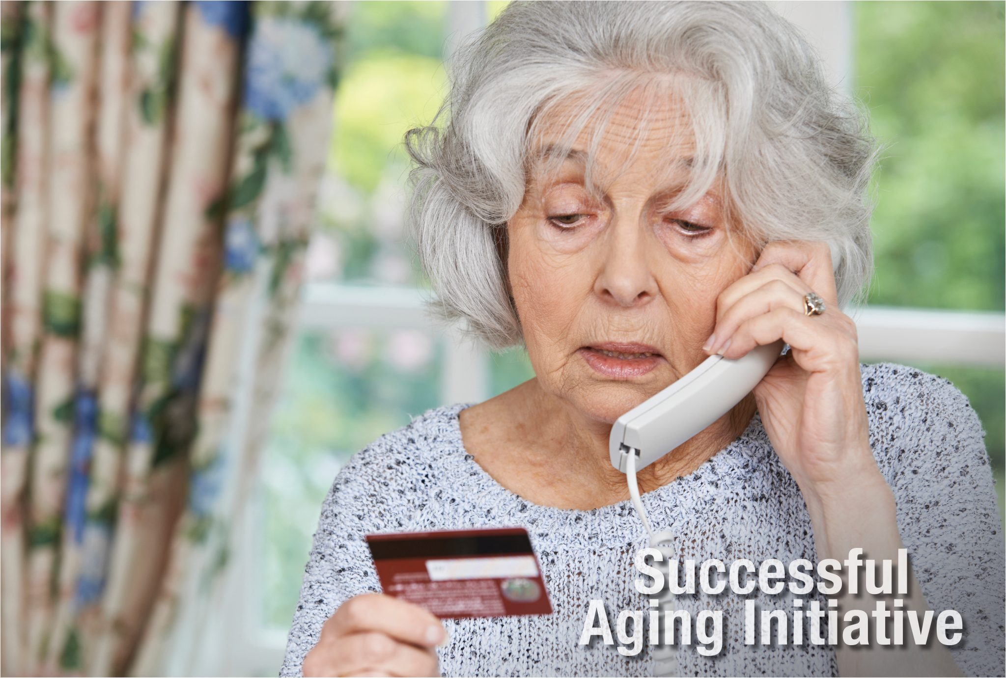 Senior adult on the telephone holding a credit card