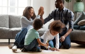 African American family playing indoors